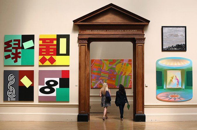 Visitors walk through the Royal Academy galleries during the Summer Exhibit